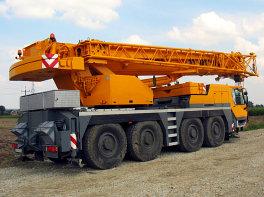 orange crane truck on the road