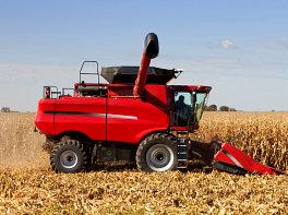 farm tractor harvesting a crop