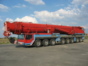 red heavy crane truck